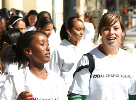 Smiling girls walking together outside