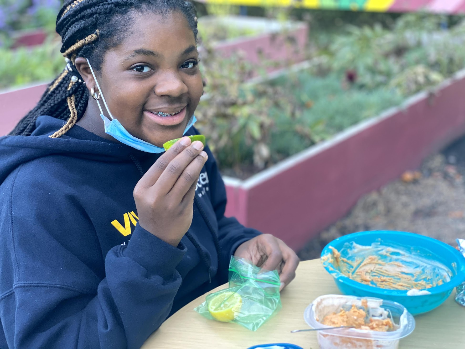 Happy Black girl having a snack outdoors